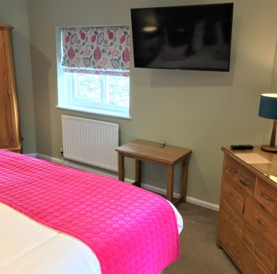 Luxury bedroom furniture at boutique Windermere hotel The Hideaway