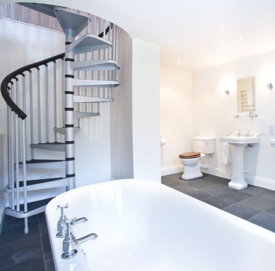 Spiral staircase in bathroom at The Hideaway at Windermere boutique hotel