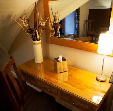 Hardwood desk at boutique hotel The Hideaway